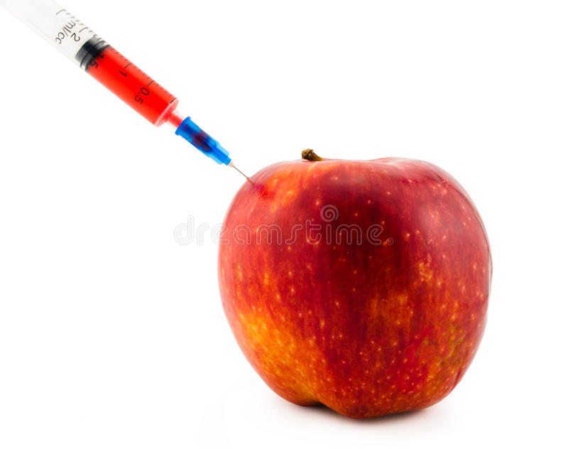 Injection in an apple stock images