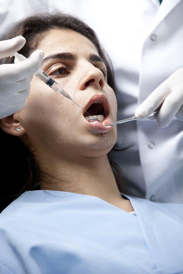 Injection de dentiste images stock
