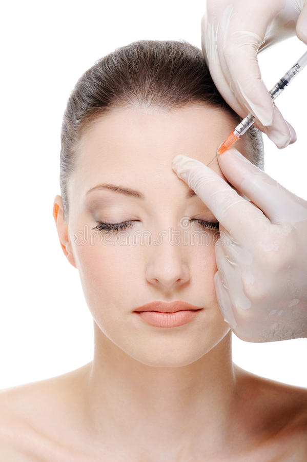 Injection in the eyebrow stock photos