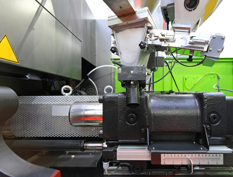 Injection moulding. Machine for plastic parts production royalty free stock photography