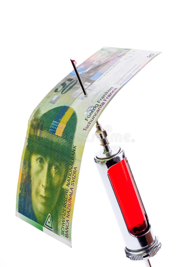 Injection needle and syringe. With swiss francs. Cost of health care policy stock photos