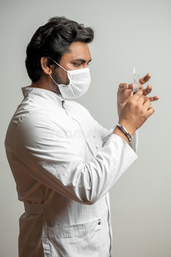 Injection before the operation. dentist is giving injection to a patient royalty free stock photography