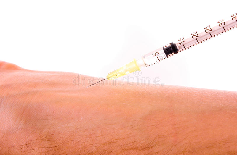 Injection with a syringe royalty free stock images