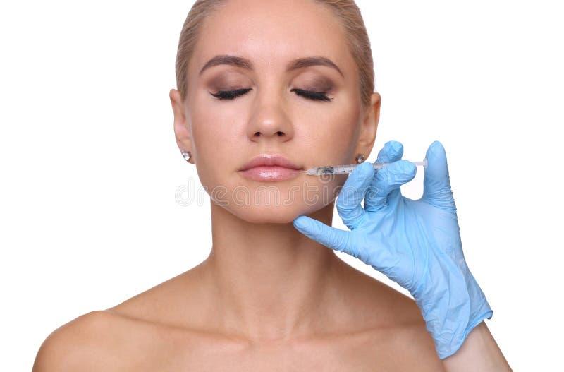 Injektion i hennes kanter arkivfoto