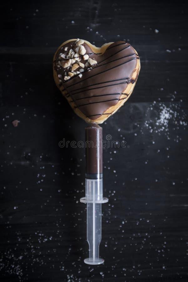 Injektion med chokladpralin fotografering för bildbyråer