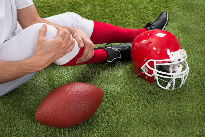 Injured american football player royalty free stock photos