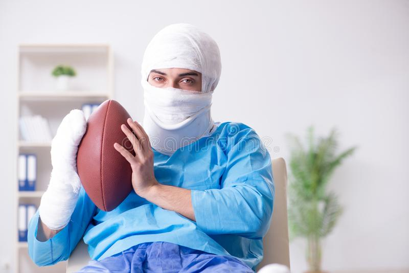 The injured american football player recovering in hospital. Injured american football player recovering in hospital royalty free stock photos