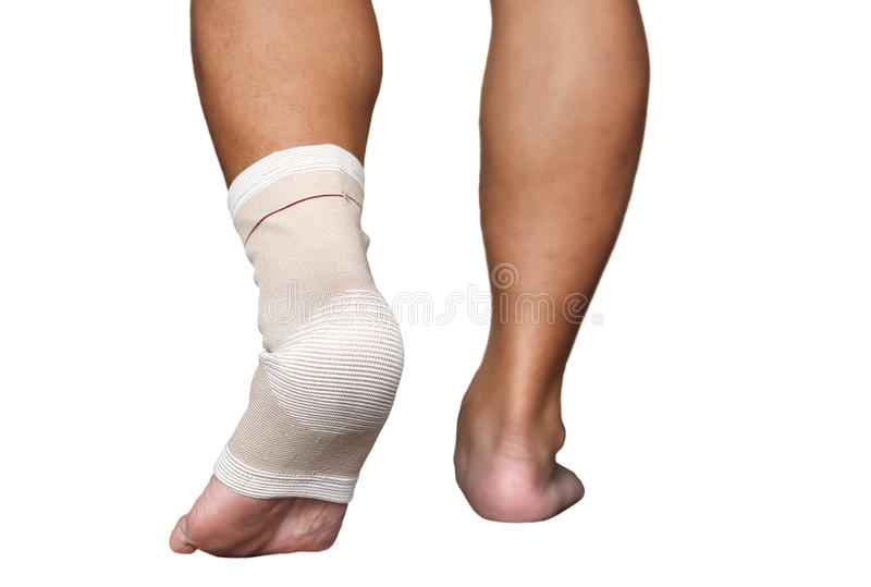 Injured ankle and foot wrapped in bandage isolated stock images