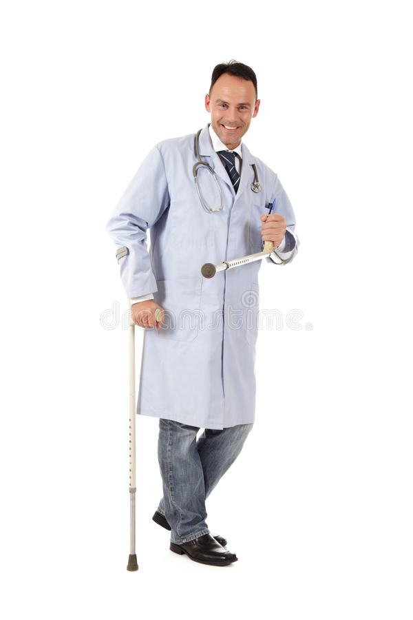 Injured caucasian man doctor. Smiling Middle aged injured, handicapped, caucasian man doctor. Studio shot. White background royalty free stock images