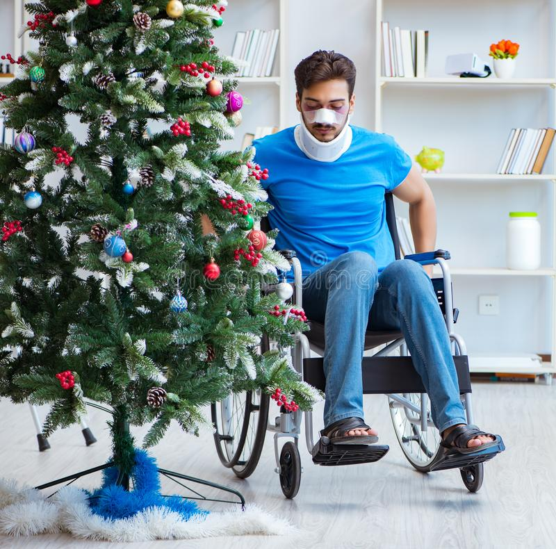 Injured disabled man celebrating christmas at home royalty free stock photography