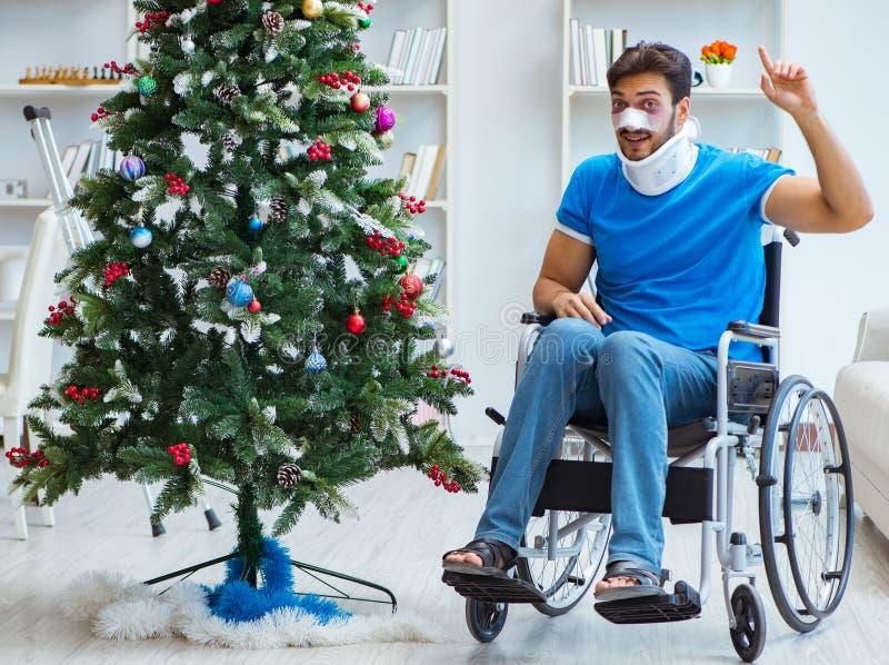 Injured disabled man celebrating christmas at home royalty free stock image