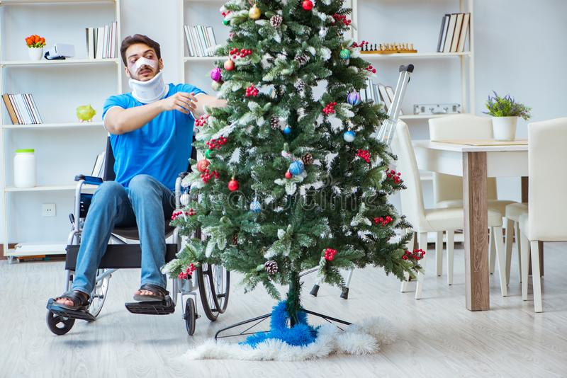 The injured disabled man celebrating christmas at home stock photo