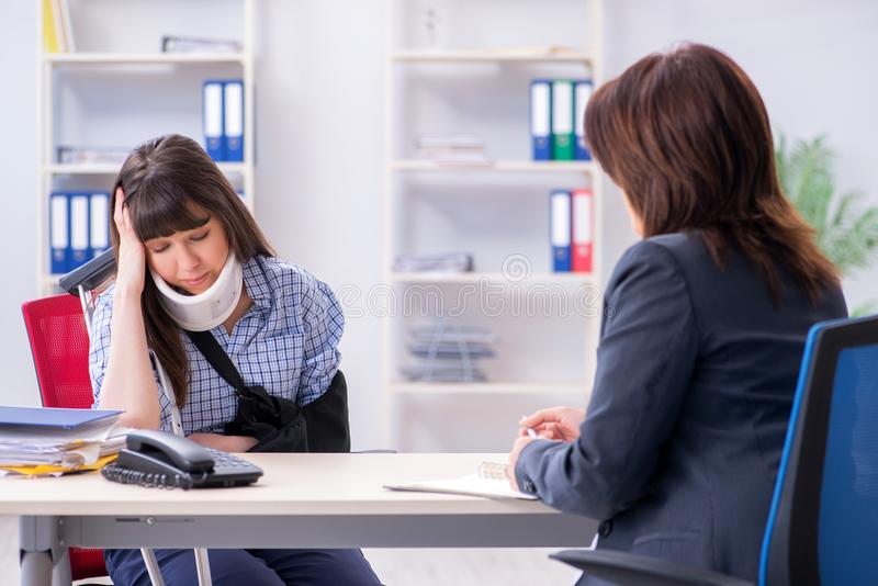 The injured employee visiting lawyer for advice on insurance royalty free stock images