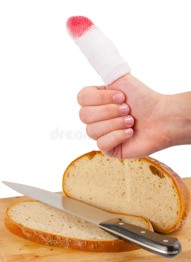Injured finger with bleeding while cutting bread royalty free stock image