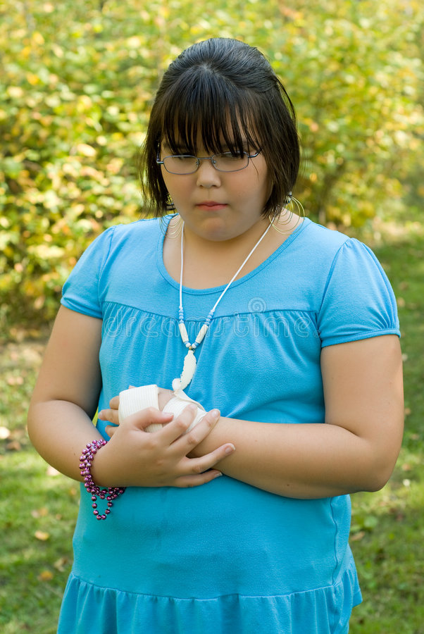 Injured Girl. A young girl hurt herself and put the tensor bandage on herself stock image
