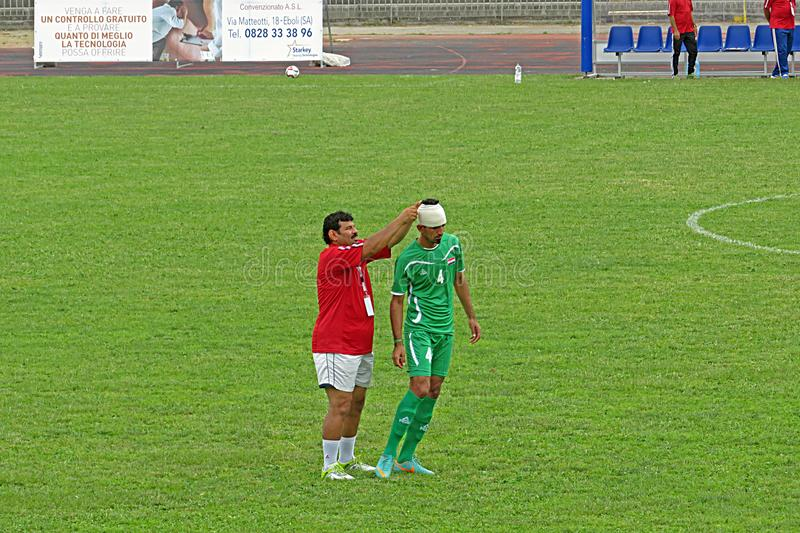 Injured iraqi player. A injured player of iraq national team during the deaf football world cup match italy vs iraq played at eboli in italy royalty free stock photo
