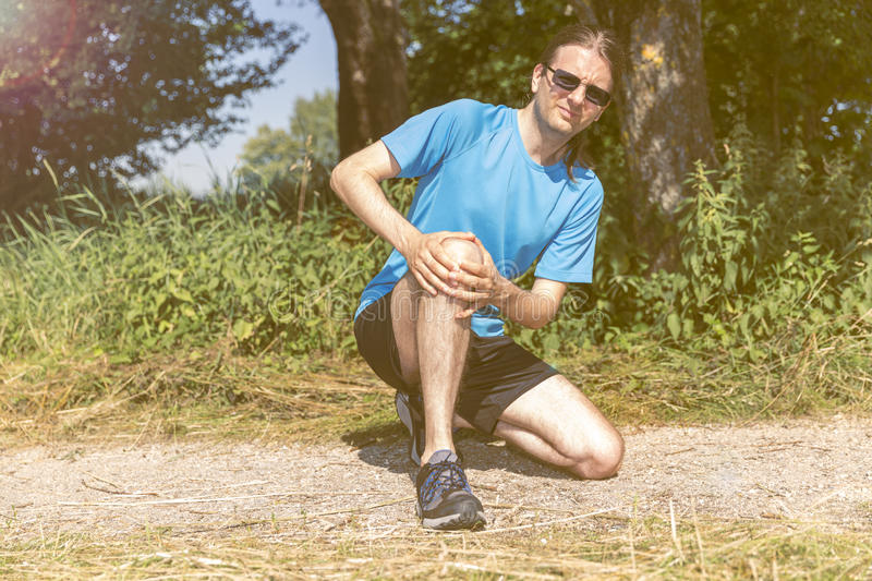Injured jogger man royalty free stock images