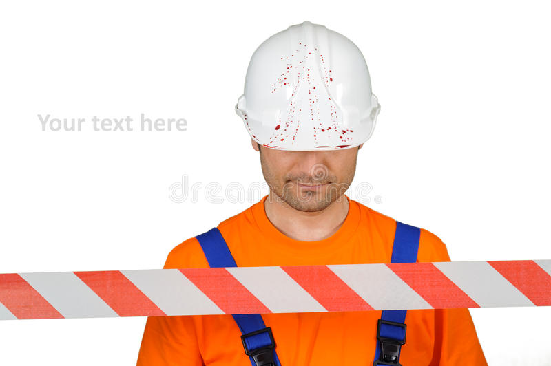 Injured laborer at accident scene hard hat with blood and warning tape on white. Background stock image