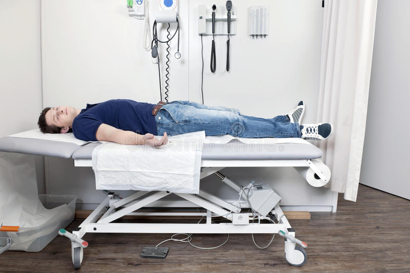 Injured Man In The Clinic Royalty Free Stock Photo