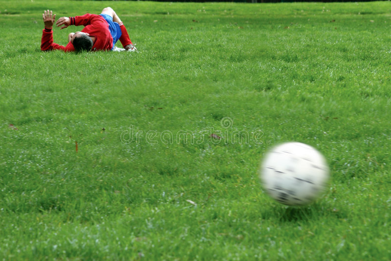 Injured player. On the soccer field royalty free stock photo