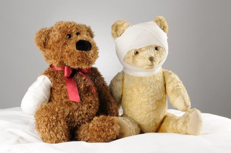 Injured teddy bears stock photography
