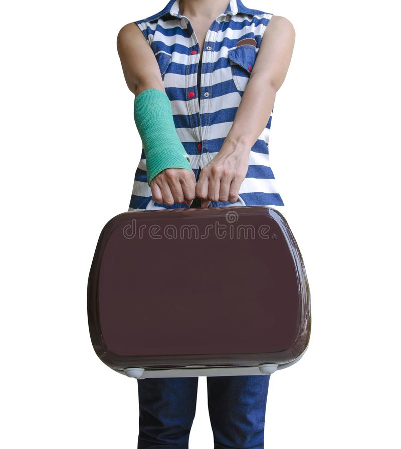 injured woman traveler broken arm in green cast standing and holding suitcase isolated on white background, clipping path included royalty free stock photography
