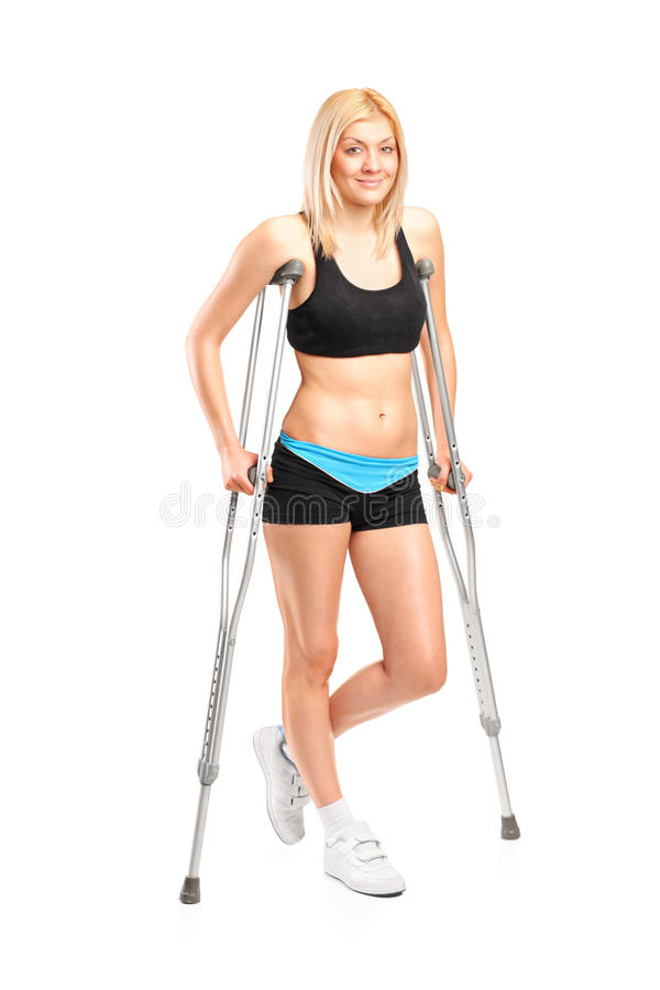 Download Injured Young Fenmale On Crutches Stock Photo - Image: 23470418