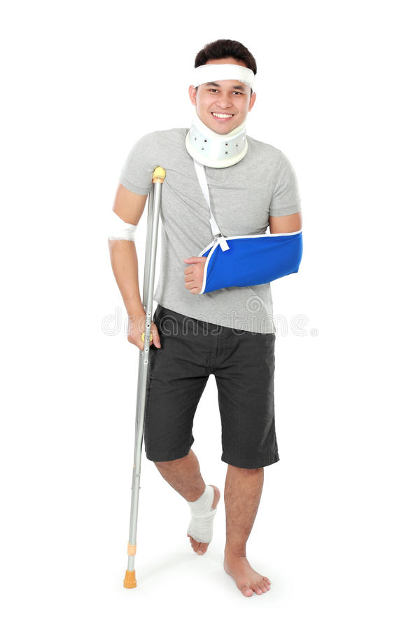 Injured young man on crutch royalty free stock photos