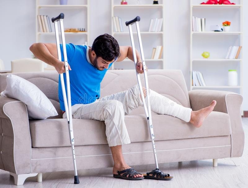 Injured young man recovering at home. The injured young man recovering at home stock photos