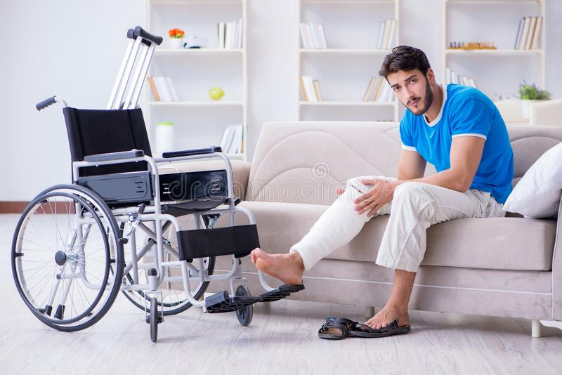 The injured young man recovering at home. Injured young man recovering at home royalty free stock photos