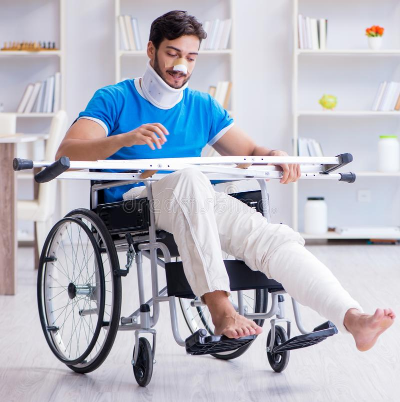 Injured young man recovering at home. The injured young man recovering at home stock image