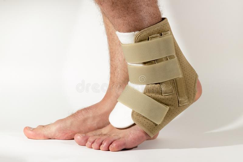 Injury of leg, sprain of ligaments. Bandage on the foot. The con stock photo