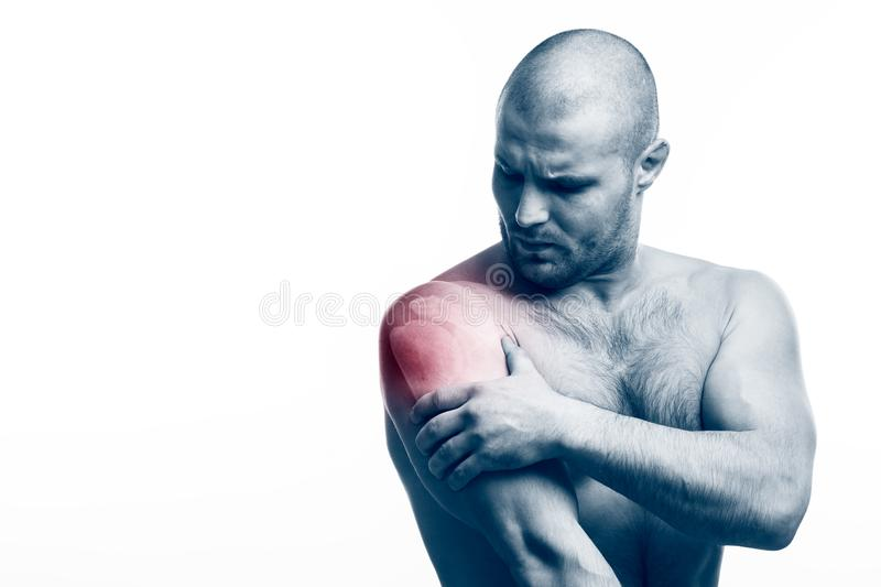 Injury of the forearm. Injury to forearm, shoulder pain Young balding athletic man holding a sore arm on a white isolated background stock photos