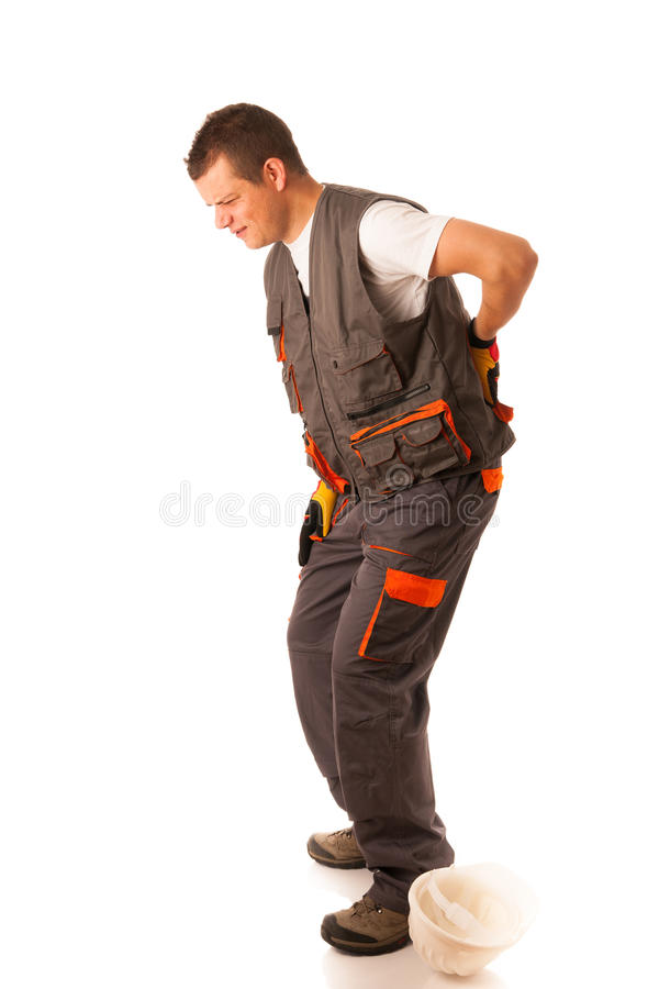 Injury on work - construction worker suffering hard pain. In his back royalty free stock images