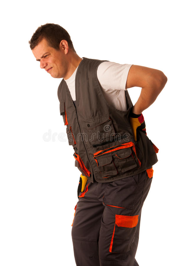 Injury on work - construction worker suffering hard pain. In his back stock images