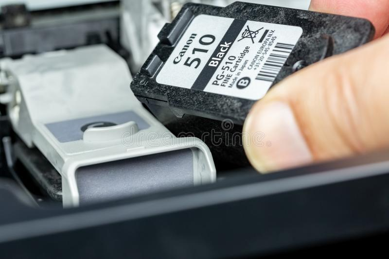Ink cartridge replacement on an inkjet printer stock images
