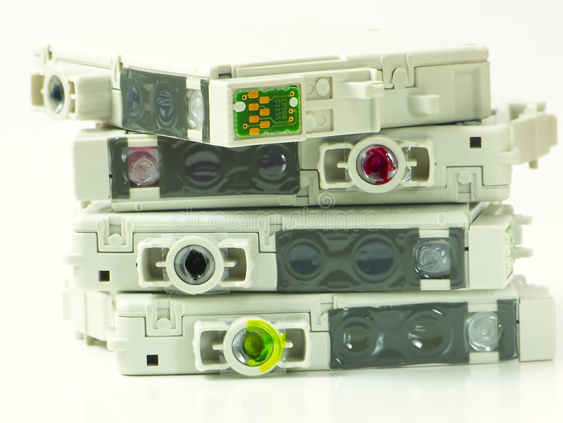 Ink Cartridges. Four ink cartridges for ink-jet printer stock photography