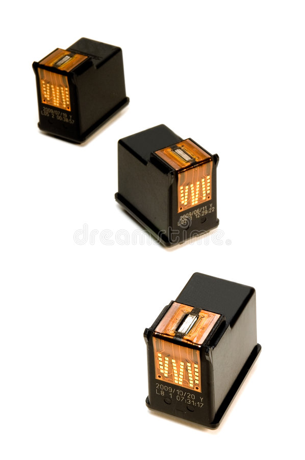 Ink cartridges. Over white background royalty free stock image