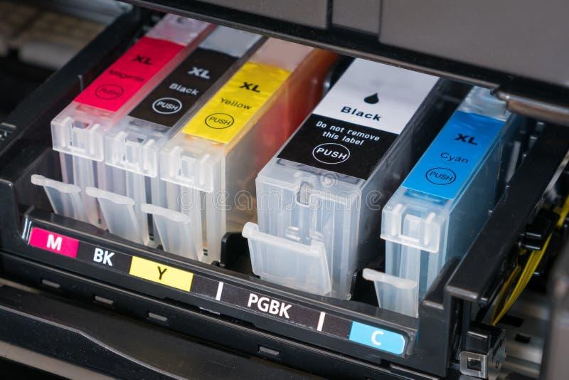 Printer ink cartridges. Ink cartridges inside printer - open ink printer royalty free stock images