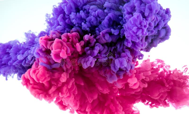 Ink color splash in water - mix background stock photos