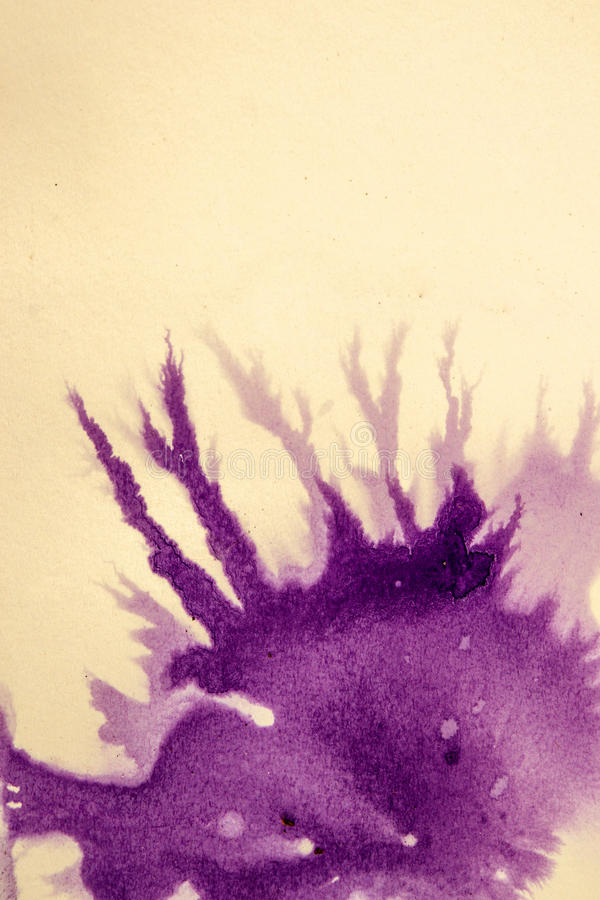 Ink drips on white paper. Ink purple drops and splatters on white background stock image