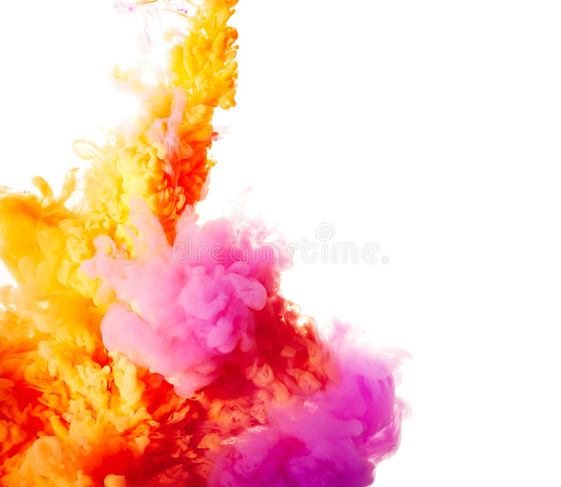 Ink drops in water over white. Orange and purple ink drops in water over white stock images