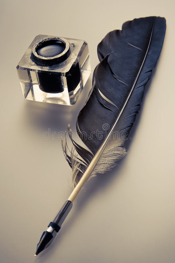 Ink and feather pen stock photography