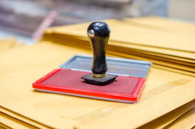 Ink pad and wooden rubber stamp.  royalty free stock photography