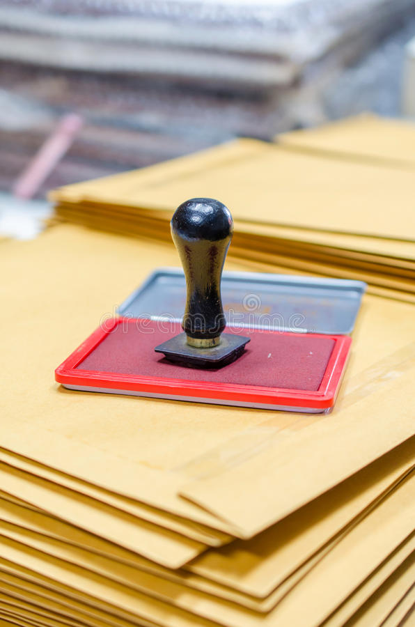 Ink pad and wooden rubber stamp.  royalty free stock photos