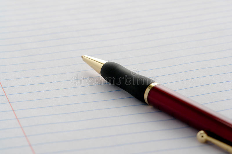 Ink Pen on Empty Blank Notebook Ruled Paper Sheet stock image