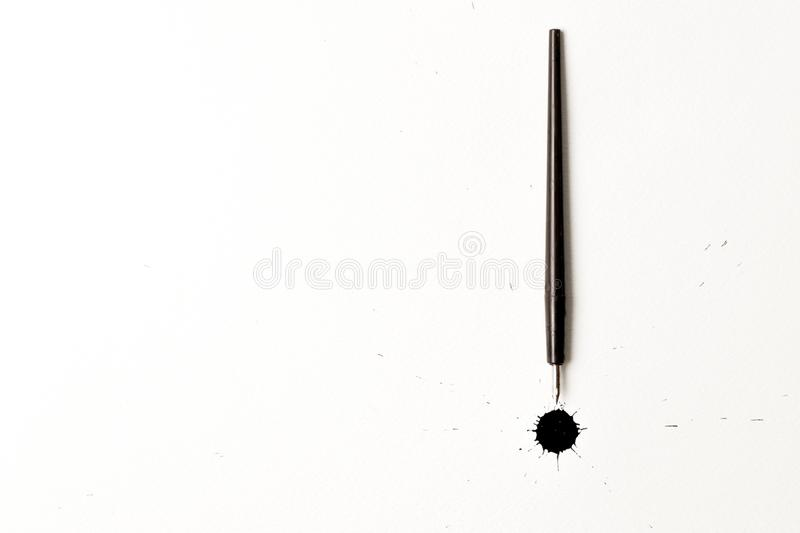 Ink spots and calligraphy pen royalty free stock photo