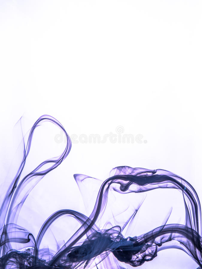 Ink swirl in a water on color background. The paint splash in the water. Soft dissemination a droplets of colored ink in stock image