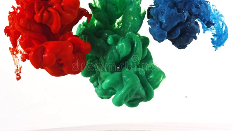 Ink swirling in water, Color drop in water photographed in motion royalty free stock image
