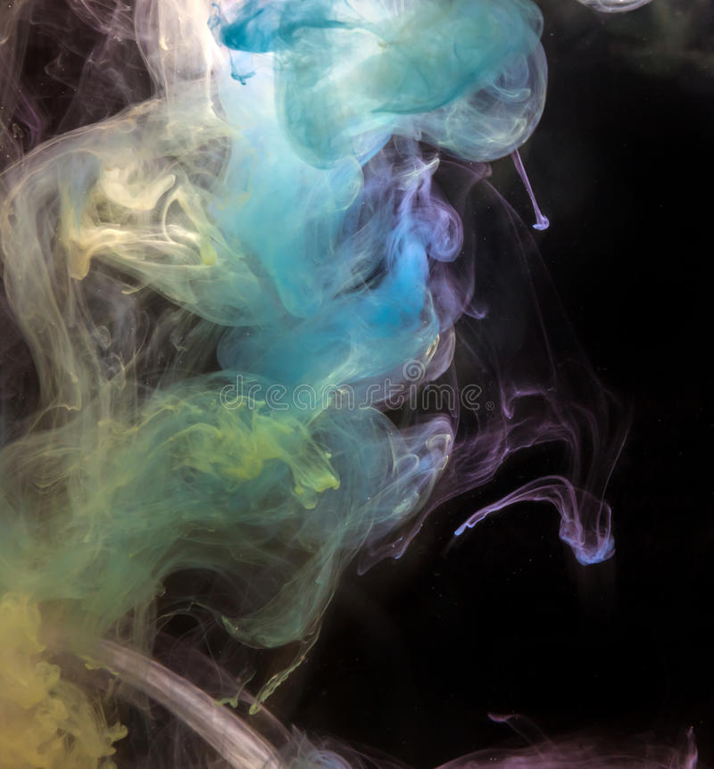 Ink in water. Ink in water on a black background royalty free stock images